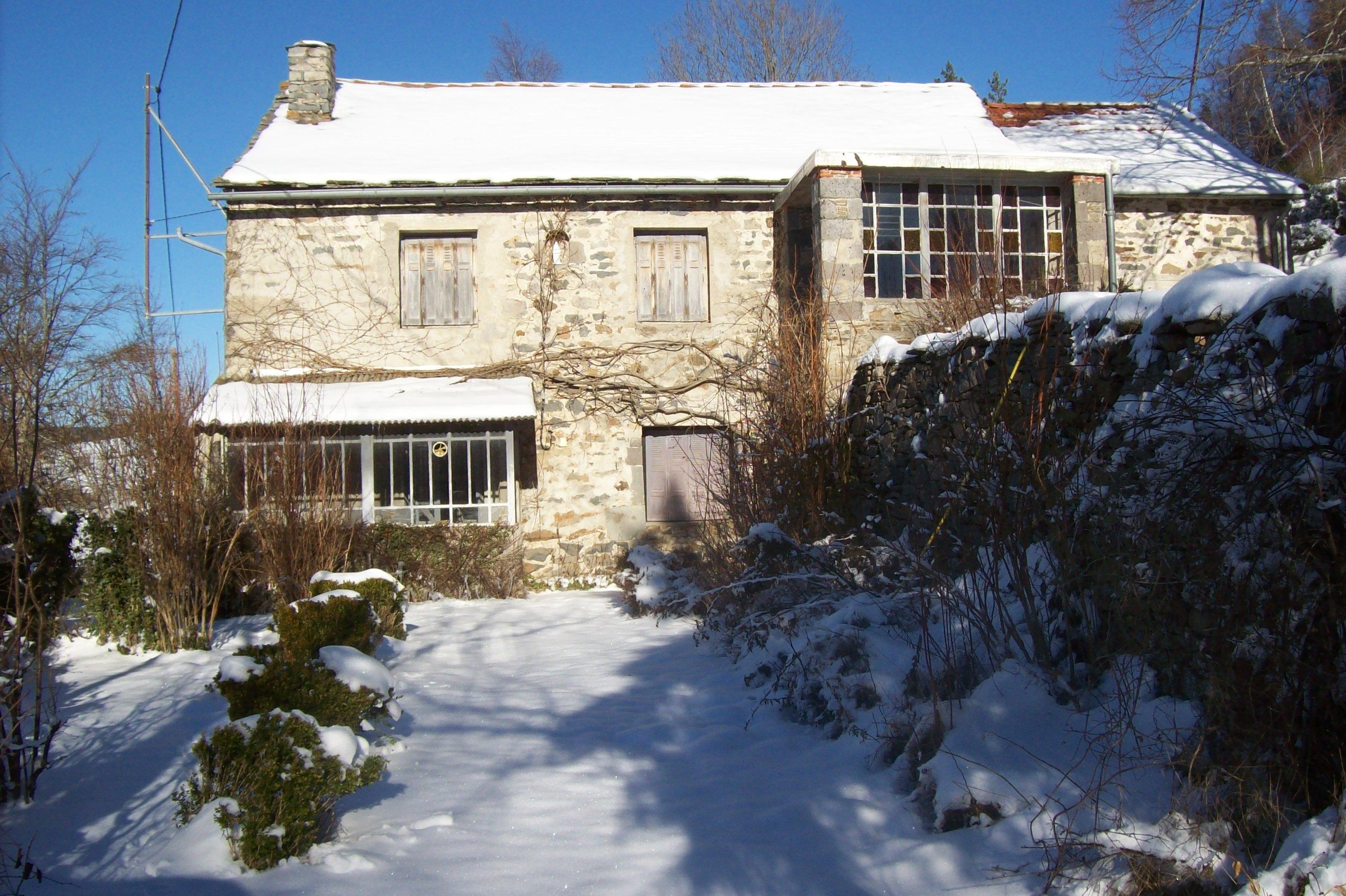 Rénovation d'une maison en pierre à Queyrières